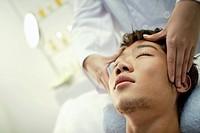 Man getting temple massage