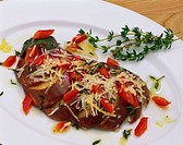 Aubergine fan with diced red pepper and Parmesan