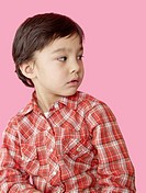 Asian boy wearing a checked shirt