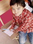 Asian boy with paper and pen