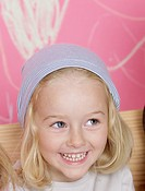 Blond girl wearing a headscarf
