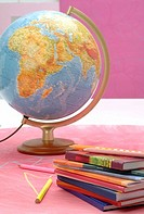 Globe, notebooks and crayons