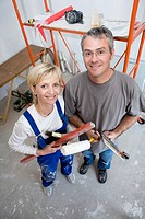 Portrait of mature couple restoring flat, elevated view