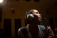 Woman singing in recording studio