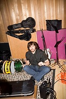 Drummer surrounded by instruments