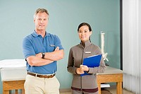 Multi-ethnic physical therapists in office