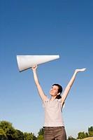 Woman holding megaphone over head
