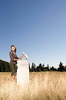 Businesswoman next to copier in field