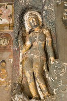 Close-up of a statue in a cave, Ajanta, Maharashtra, India