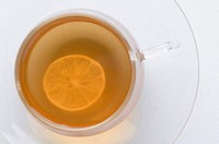 Slice of lemon in a cup of herbal tea
