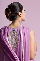 Rear view of a mid adult woman standing in salwar kameez