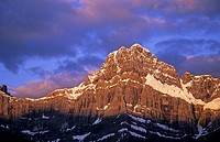 Alpenglow lights up a peak at sunrise, Banff National Park, Alberta, Canada