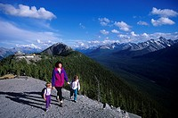 Woman and two sons hike above chalet, Sulphur Mountain, Alberta, Canada