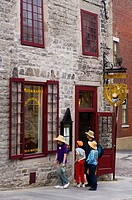 Family considers restaurant in Old Montreal, Quebec, Canada