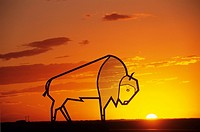 Steel bison sculpture at sunset, Balgonie Saskatchewan, Canada