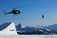 Aerial competetion on whistler mountain with black tusk and the tantalus range in the background, british columbia, Canada
