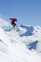 Skier getting air in Whistlers backcountry, British Columbia, Canada