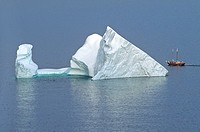 Iceberg and sailing ship off St  John´s Newfoundland, Canada