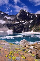 Cobalt Lake with ice, North Post Spire, Bugaboo Glacier Provincial Park, British Columbia, Canada