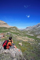 Hiker enjoys the view out over the Banff backcountry in Banff National Park looking towards the Siffleur Wilderness in the Canadian Rockies, Alberta, ...