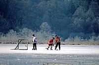 Kids playing hockey on Burnaby Lake, Burnaby Lake Regional Park, Burnaby, British Columbia, Canada