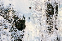 Ice Climbers scaling iced wall of Baker´s Brook Pond, Gros Morne National Park, UNESCO, World Heritage Site, Newfoundland, Canada