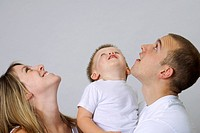 Young family looking up at the same time