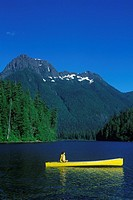 Schoen Lake with yellow canoe, woman paddling, Vancouver Island, British Columbia, Canada