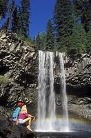 Couple at rest beside Hendrix Falls, British Columbia, Canada