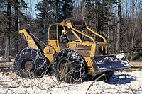 Skidder pulling logs, Bulkley Valley, British Columbia, Canada