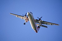 DeHavilland DHC-8 Dash 8 turbo-prop airplane taking off from Smithers Airport, British Columbia, Canada
