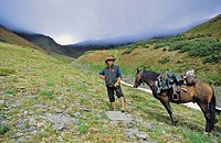 man and his horse Bonus, Muskwa Kechika Wilderness, Northern Rockies, British Columbia, Canada