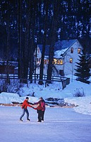 Family skates on outdoor ice rink, Pemberton, British Columbia, Canada