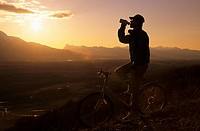 Mountain biker at sunset, Bulkley Valley, British Columbia, Canada