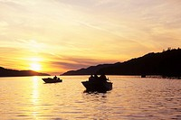 Boat salmon fishing at sunset, Work Channel, Prince Rupert, British Columbia, Canada
