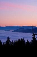 Malahat lookout over Finlayson Arm, north of Victoria at sunset with fog below hilltops, Vancouver Island, British Columbia, Canada