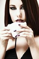 Woman holding cup, portrait