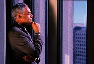 Businessman Staring out the Window