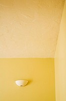 Sconce on Wall in Yellow Room
