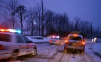 Police and Paramedics Racing to the Scene of a Snowy Highway Accident
