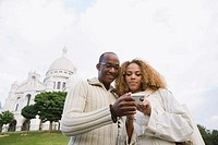 African couple taking own photograph