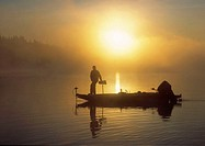 bass fisherman at sunrise