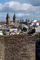 Lugo. Galicia. Spain. Roman walls (Lucus Augusti, old roman town) and Santa Maria cathedral in background