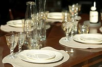 Table Set With White Dishes and Clear Glass