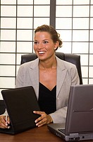 Business Woman Smiling at Desk
