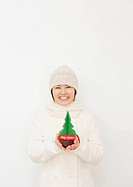 Woman Holding Miniature Christmas Tree