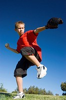 Kid Pitching a Baseball