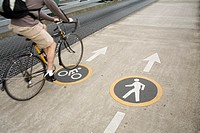 Bicyclist Following Signs