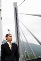 Businessman Walking on a Bridge