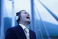 Businessman Listening to Music and Shouting